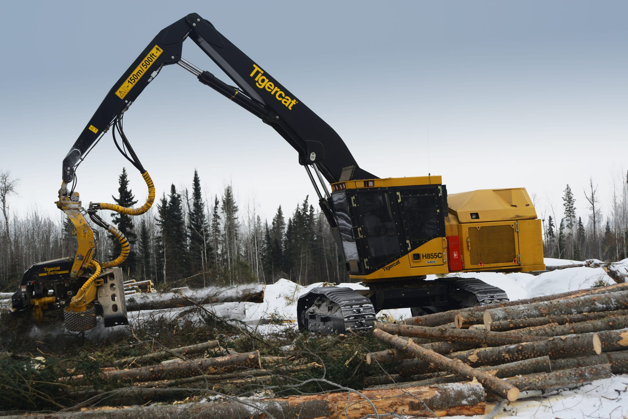 Harvester collecting logs